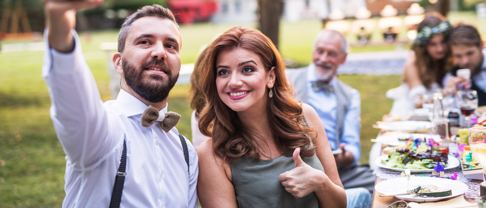 Couple dating a selfie at a wedding dinner
