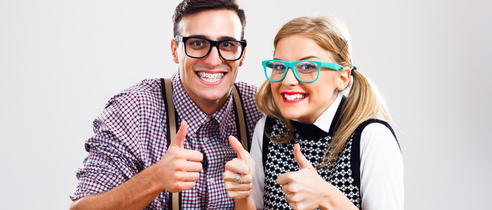 Couple dressed up as nerds in glasses and plaid sweaters