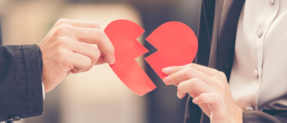 Getting a divorce symbolized by a broken heart out of paper