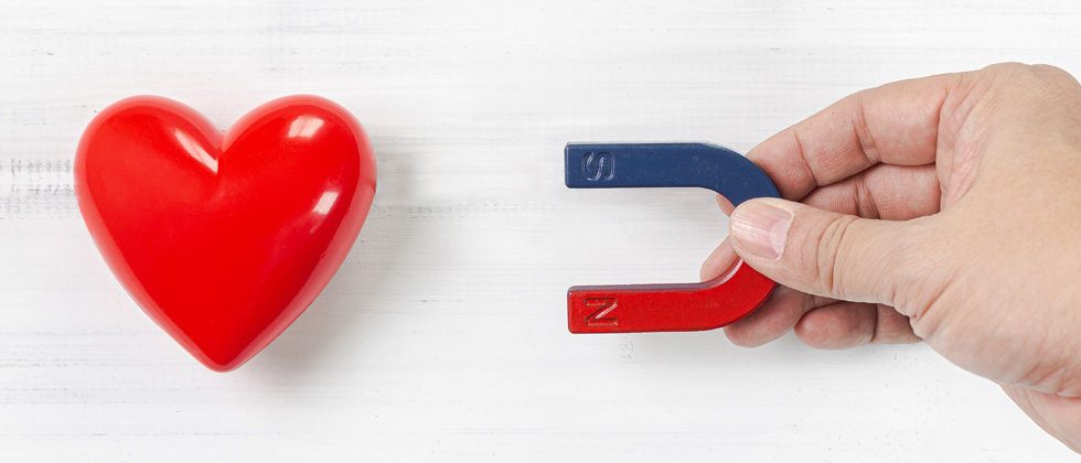 A magnetic pulling a heart towards it