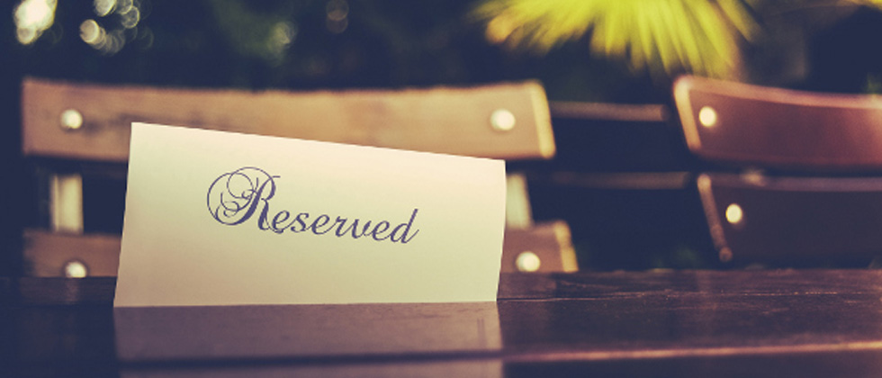 A picture of a reserved sign on a table