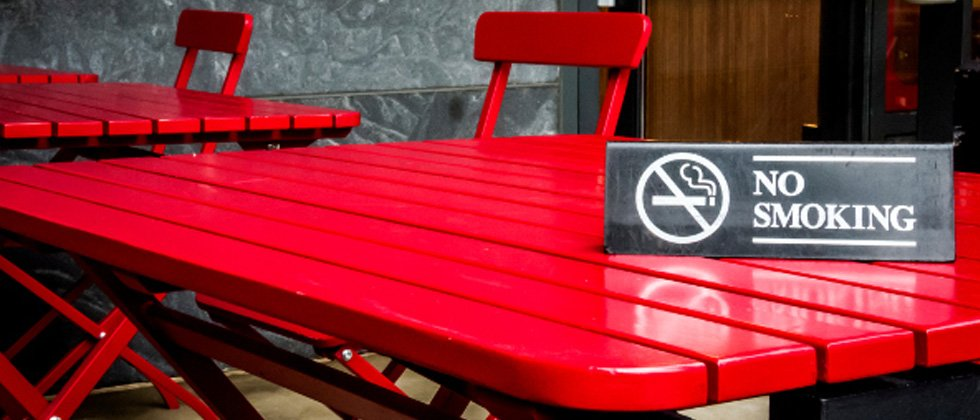 A red table with a NO SMOKING sign on it