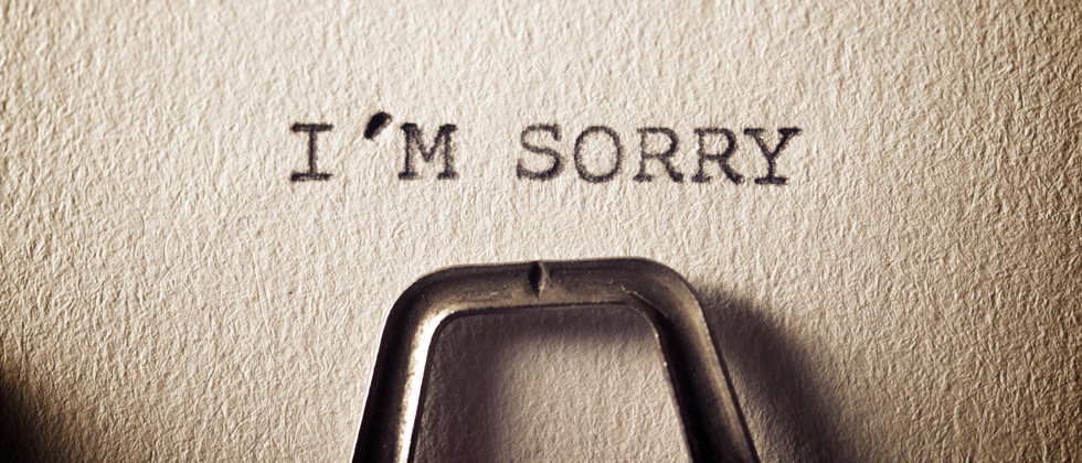 A piece of paper in a typewriter that says I'M SORRY