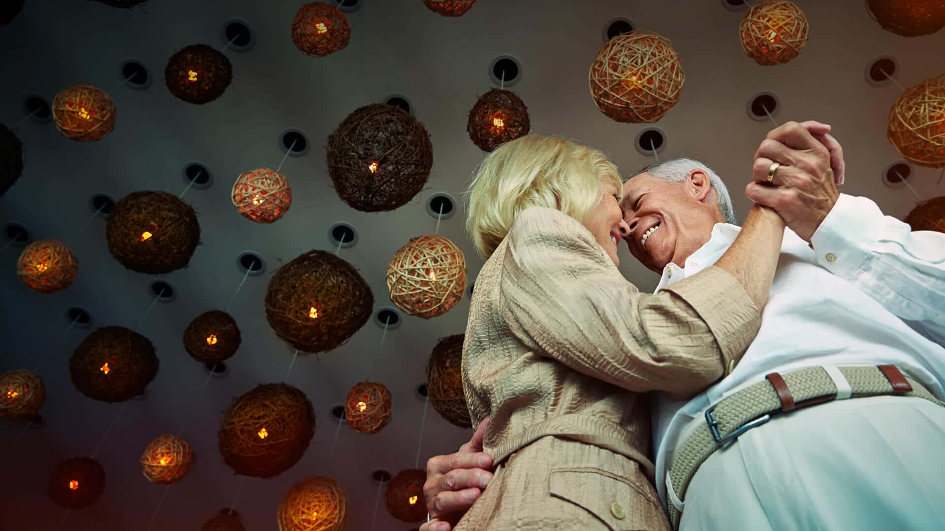 Senior dating symbolized by a couple that is dancing happily in love in a romantic atmopshere in Canada