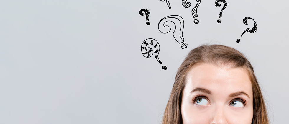 A girl thinking with a bunch of question marks drawn over her head