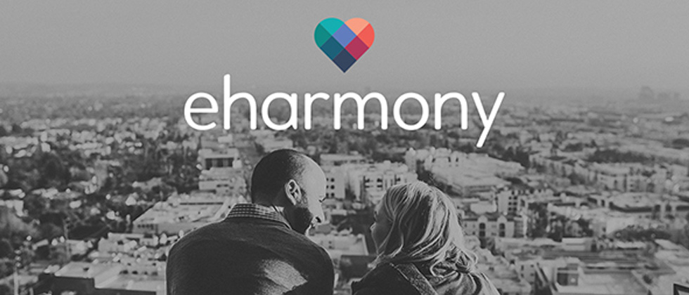 The colorful eharmony logo with a couple looking out onto the city