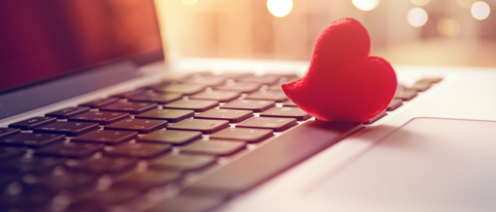 A small cutout heart resting on a keyboard