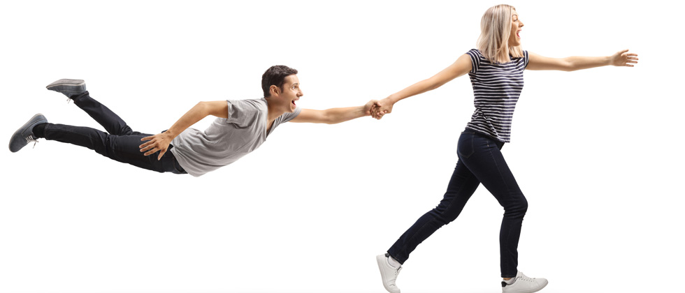 Woman pulling guy's hand and pulling him toward the future